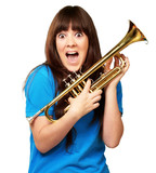 surprised woman holding trumpet