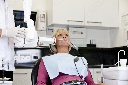 A female patient having an x-ray at the dentist