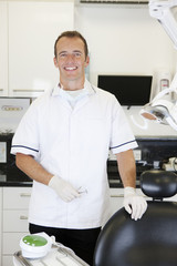 A male dentist in a dental surgery