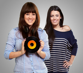 Two Happy Woman Holding Vinyl Disc