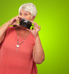 Senior Woman Holding Camera