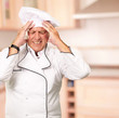 Portrait Of Chef With Painfully Head