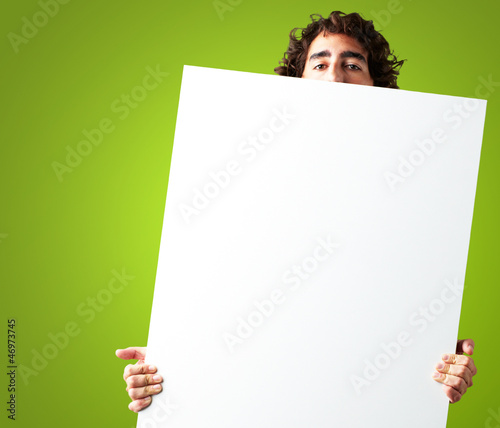 Portrait Of Man Holding a blank billboard