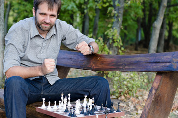 Middle aged man playing chess with himself