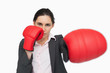Serious woman wearing red gloves punching