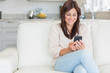 Brunette texting with mobile phone