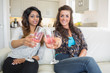 Two girls clinking glasses of champagne