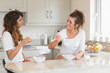 Two women eating bowls of cereal