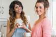 Happy women holding coffee cups