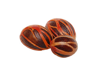 Three whole nutmeg seeds covered in mace
