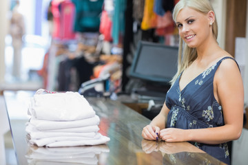 Smiling woman behind counter