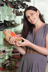 Woman holding a shoe