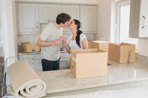 Happy couple kissing in the kitchen