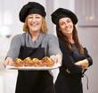 Portrait Of Two Happy Chef