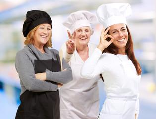 Three Happy Female Chef Gesturing
