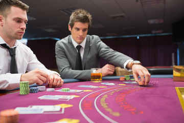 Man placing bet in poker game