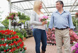 Couple strolling through garden center