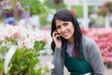 Smiling florist outside the garden centre