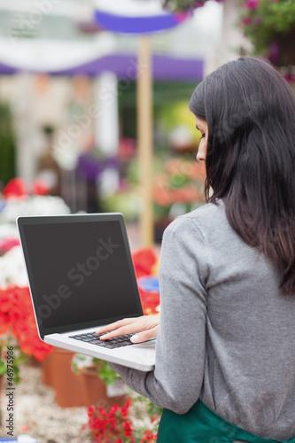 Florist using a laptop