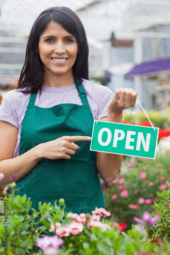 Woman holding an open sign