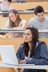 Girl sitting at the lecture hall concentrating