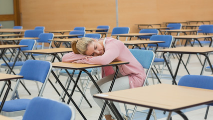Woman napping in exam hall