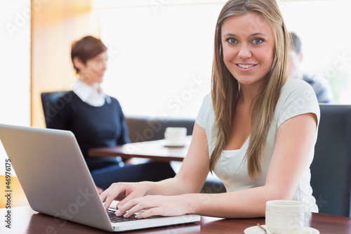 Student sitting at the coffee shop with laptop