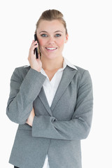 Cheerful businesswoman calling