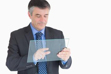 Businessman pressing something on pane