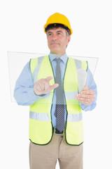 Architect using glass pane as digital tablet