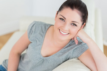 Smiling woman sitting on the couch