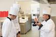 Upset head chef scolding employees