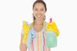 Smiling woman holding up spray bottle