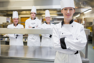 Chef standing with her arms crossed