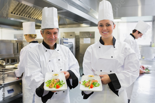 Two Chef's showing salmon dishes