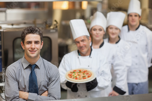 Waiter standing in front of Chef's