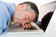 Man sleeping on his laptop