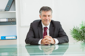 Man smiling in his office