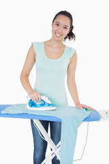 Woman happily doing the ironing