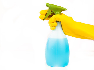 Hand holding spray bottle
