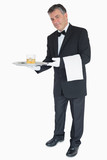 Waiter offering whiskey with ice