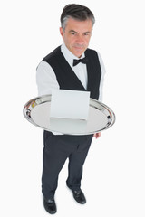 Man serving silver tray with blank card