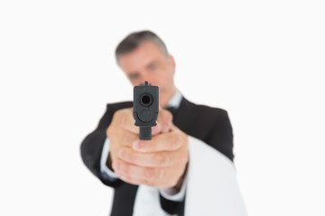 Waiter holding gun directly ahead