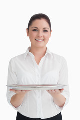 Waitress holding tray with two hands
