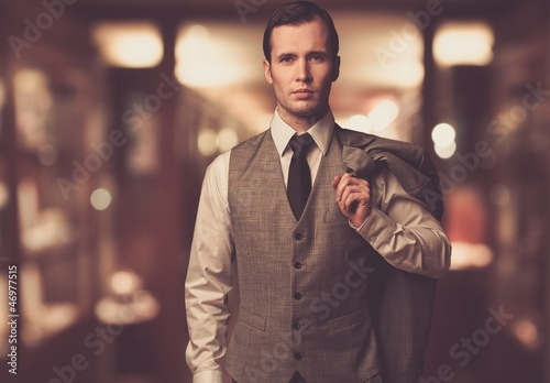 Man in waistcoat with  against blurred background