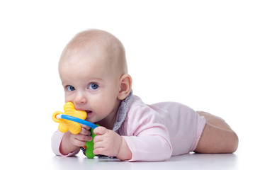 teething baby with toy