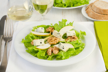 salad with gorgonzola, pear and walnut in the white plate