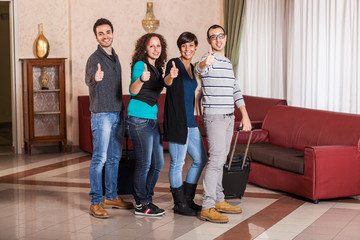 Happy Tourists with Thumbs Up