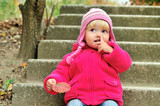 baby girl picking her nose