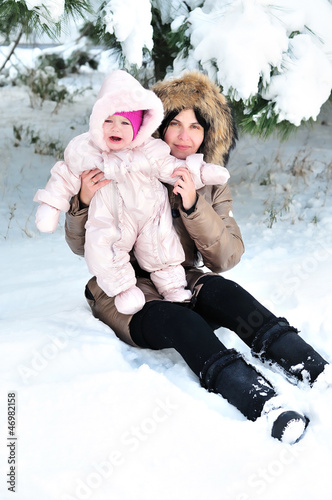 mother with her baby in snow